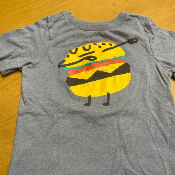 Short sleeve T-shirt with cheeseburger design.